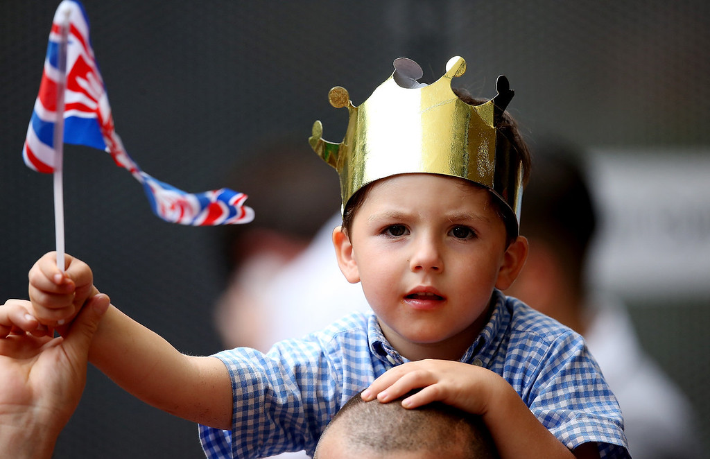 Description of . A young well wisher waits outside The Lindo Wing as he awaits Catherine, Duchess Of Cambridge and her newborn son at  on July 23, 2013 in London, England. The Duchess of Cambridge yesterday gave birth to a boy at 16.24 BST and weighing 8lb 6oz, with Prince William at her side. The baby, as yet unnamed, is third in line to the throne and becomes the Prince of Cambridge.  (Photo by Scott Heavey/Getty Images)