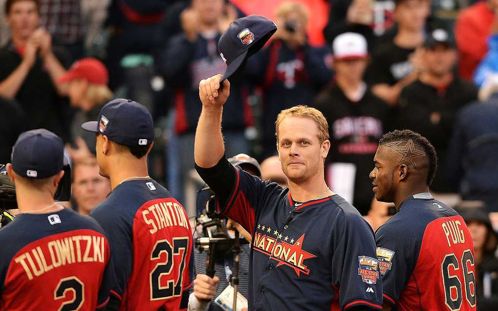 Description of . Former Minnesota Twins Justin Morneau, now playing for the Colorado Rockies, is given a standing ovation as he is announced as one of the National League hitters during the MLB All-Star Home Run Derby at Target Field in Minneapolis on Monday, July 14, 2014.  (Pioneer Press: John Autey)
