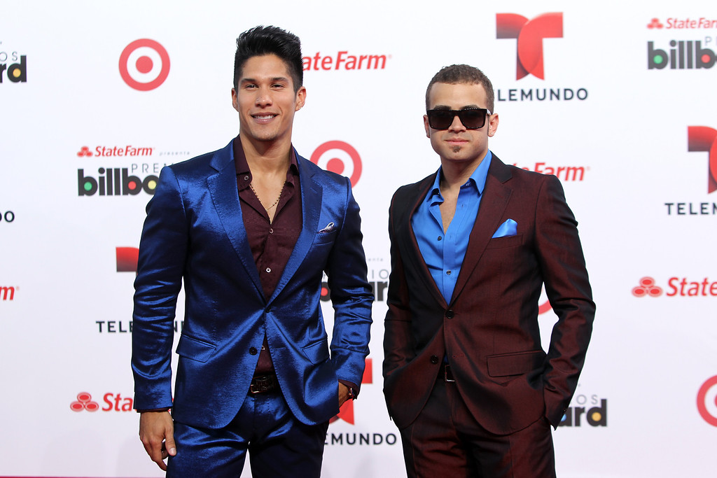 Description of . Singer Chino and Nacho arrive at the Latin Billboard Awards in Coral Gables, Fla. Thursday, April 25, 2013. (Photo by Carlo Allegri/Invision/AP)