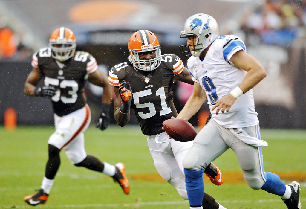 Description of . Cleveland Browns linebacker Barkevious Mingo (51) chases Detroit Lions quarterback Matthew Stafford (9) in the second quarter of an NFL football game Sunday, Oct. 13, 2013 in Cleveland. (AP Photo/David Richard)