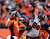 Denver Broncos quarterback Peyton Manning #18 throws during the fourth quarter as Tampa Bay Buccaneers defensive tackle Roy Miller #90 rushes him. The Denver Broncos vs The Tampa Bay Buccaneers at Sports Authority Field Sunday December 2, 2012. Joe Amon, The Denver Post