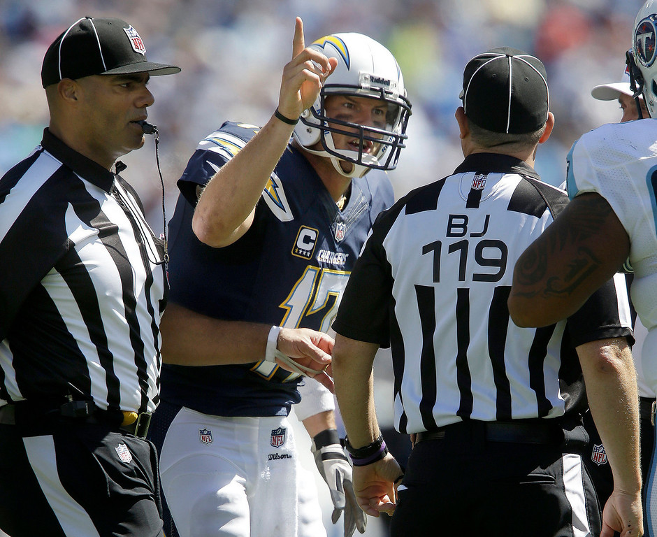 Description of . San Diego Chargers quarterback Philip Rivers (17) argues with back judge Greg Wilson (119) after offensive pass interference was called against the Chargers in the second quarter of an NFL football game against the Tennessee Titans on Sunday, Sept. 22, 2013, in Nashville, Tenn. Rivers was penalized for unsportsmanlike conduct as a result. (AP Photo/Mark Zaleski)