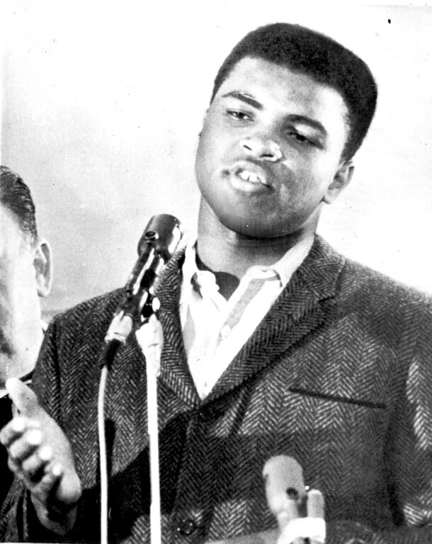 Description of . Cassius Clay, the new Heavyweight champion after defeating Sonny Liston last night, gives his version of the fight at a press conference here this morning.  The champion was in a much more relaxed mood than yesterday when he almost broke up the weigh in ceremonies with a shouting and fist-waving demonstration.   1964. Credit: AP