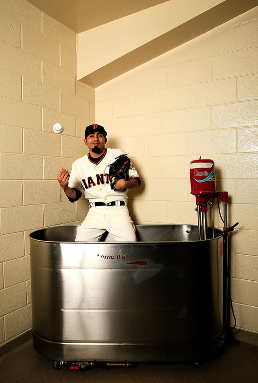 Description of . SCOTTSDALE, AZ - FEBRUARY 20:  Pitcher Sergio Romo #54 poses for a portrait during San Francisco Giants Photo Day on February 20, 2013 in Scottsdale, Arizona.  (Photo by Jamie Squire/Getty Images)