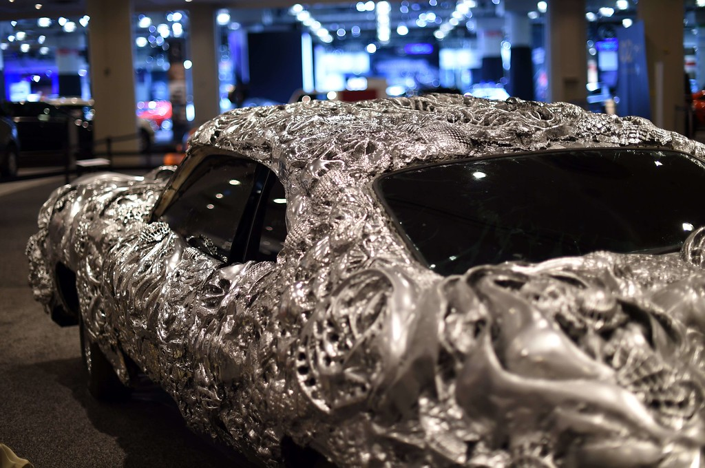 Description of . Artist Ioan Florea transformed the iconic muscle car, a Gran Torino, into a 3D piece of art by covering the car in a new metal surface with printed appliques is seen during the second press preview day at the 2014 New York International Auto Show  April 17, 2014 at the Jacob Javits Center in New York. AFP PHOTO / Timothy A. CLARY/AFP/Getty Images