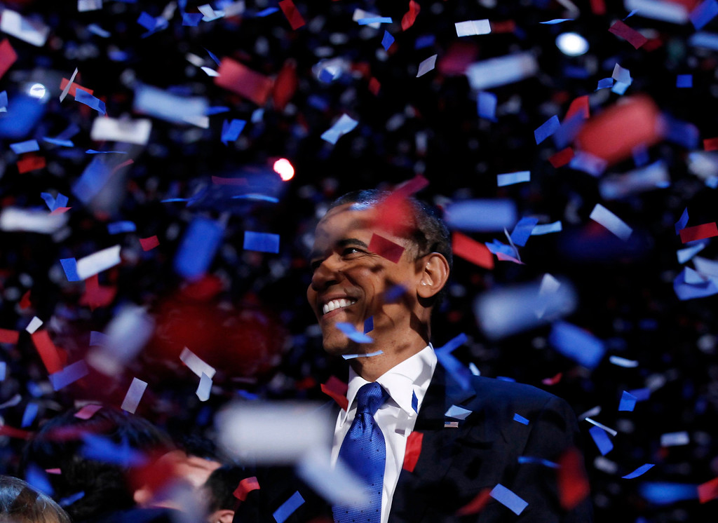 Description of . U.S. President Barack Obama celebrates on stage as confetti falls after his victory speech during his election rally in Chicago, November 6, 2012. REUTERS/Kevin Lamarque