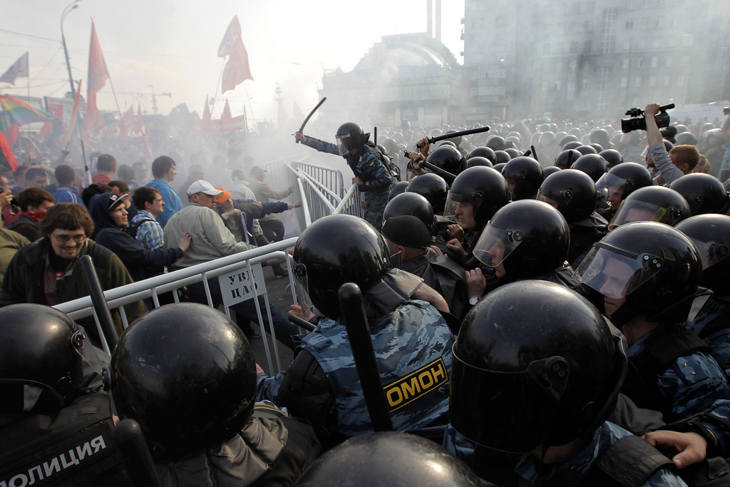 Description of . In this May 6, 2012 file photo, Russian riot police disperse opposition protesters in downtown Moscow. Riot police in began arresting protesters who were trying to reach the Kremlin in a demonstration on the eve of Vladimir Putin's inauguration as president. (AP Photo/Sergey Ponomarev, File)