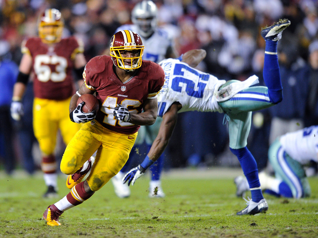 . Washington Redskins running back Alfred Morris (46) gets away from Dallas Cowboys strong safety Eric Frampton (27) during the second half of an NFL football game Sunday, Dec. 30, 2012, in Landover, Md. The Redskins won 28-18. (AP Photo/Nick Wass)
