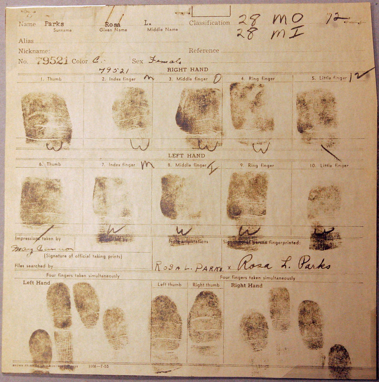 Description of . Rosa Parks original fingerprint card from her 1955 Montgomery arrest is pictured at the National Archives Southeast Region in Morrow, Ga.,  Friday Oct. 28, 2005. The National Archives provided the opportunity for the media to see select original documents relating to her 1955 Montgomery arrest in which she refused to obey the order of a bus driver to give up her seat to a white passenger. (AP Photo/John Amis)