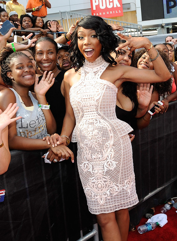 Description of . Singer Brandy attends the 106 & Park Stage Pre-Show during the BET Awards at Nokia Theatre L.A. Live on June 30, 2013 in Los Angeles, California.  (Photo by John Ricard/Getty Images for BET)