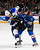 T.J. Oshie #74 of the St. Louis Blues and P.A. Parenteau #15 of the Colorado Avalanche battle for control of the puck in the first period at the Pepsi Center on February 20, 2013 in Denver, Colorado.  (Photo by Doug Pensinger/Getty Images)