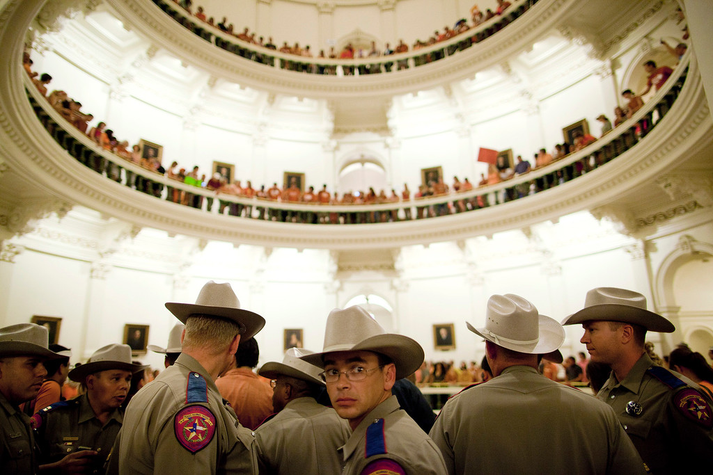 Description of . Texas State Troopers block the entrance to the State Capitol rotunda after abortion rights advocates filled it to capacity in Austin, Texas on Friday night, July 12, 2013. Republicans in the Texas Legislature passed an omnibus abortion bill that is one of the most restrictive in the nation, but Democrats vowed Saturday to fight in the courts and at the ballot box as they used the measure to rally their supporters. More than 2,000 demonstrators filled the Capitol building in Austin to voice their opposition to the bill, including six protesters who were dragged out of the Senate chamber by state troopers for trying to disrupt the debate. The Republican majority passed the bill unchanged just before midnight, with all but one Democrat voting against it.  (AP Photo/Tamir Kalifa)