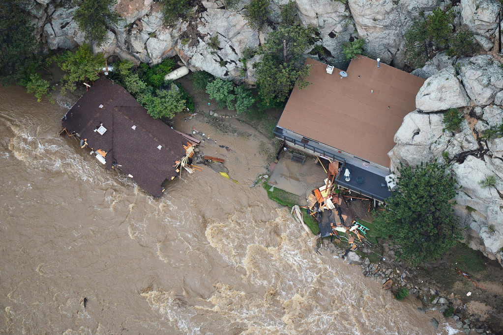 Description of . A destroyed home and what appears to be a intact, but heavily damaged home along Colorado U.S. 34 and the Big Thompson River in the Big Thompson Canyon in Larimer County Colorado Saturday morning, September 14, 2013. (Photo By Andy Cross/The Denver Post)