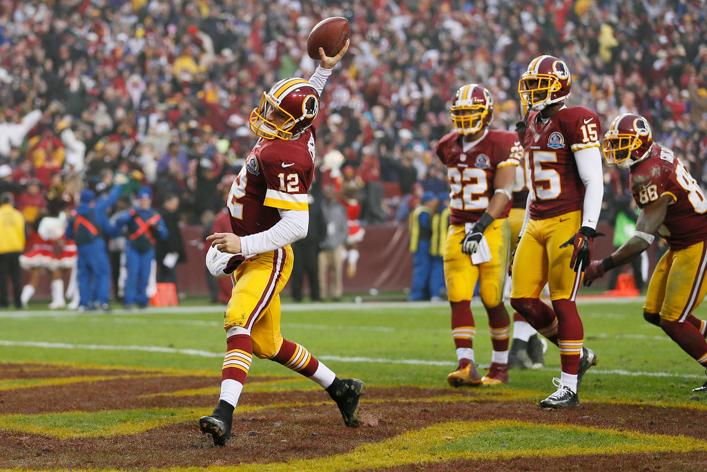 Description of . LANDOVER, MD - DECEMBER 09:  Quarterback Kirk Cousins #12 of the Washington Redskins spikes the ball in the endzone after scoring a two point conversion to tie the game with the Baltimore Ravens late in the fourth quarter forcing overtime during the Redskins 31-28 winFedExField on December 9, 2012 in Landover, Maryland.  (Photo by Rob Carr/Getty Images)