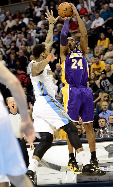 Description of . Los Angeles Lakers Kobe Bryant (R) takes a shot over the reach of Denver Nuggets Wilson Chandler (L) during their NBA basketball game in Denver, Colorado February 25, 2013. REUTERS/Mark Leffingwell