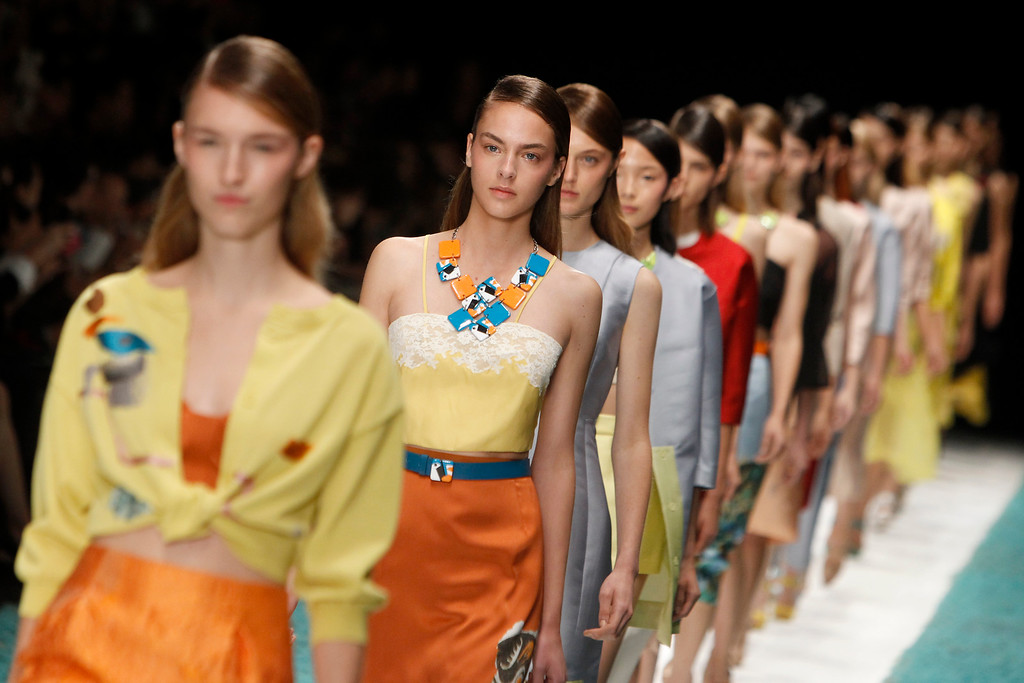 Description of . Models present creations as part of Shiatzy Chen's ready-to-wear Spring/Summer 2014 fashion collection, Tuesday, Oct. 1, 2013 in Paris. (AP Photo/Thibault Camus)