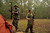 A member of the North Florida Survival Group and his young son gather their rifles before heading out to perform land navigation and enemy contact drills during a field training exercise in Old Town, Florida, December 8, 2012.  The group trains children and adults alike to handle weapons and survive in the wild. The group passionately supports the right of U.S. citizens to bear arms and its website states that it aims to teach