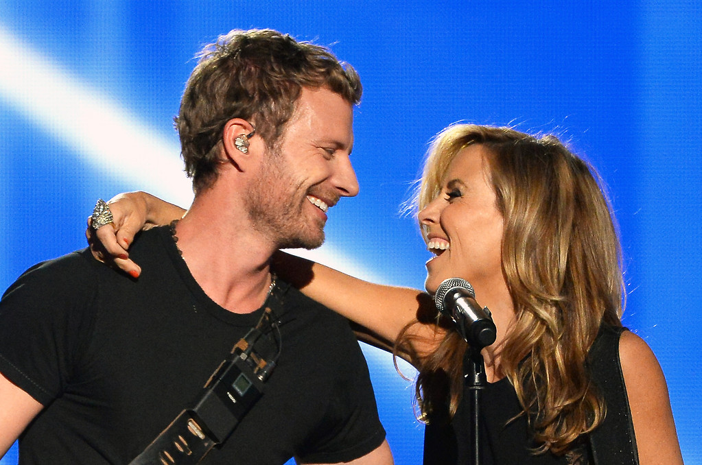 Description of . Singer/songwriters Dierks Bentley (L) and Sheryl Crow perform onstage during the 49th Annual Academy Of Country Music Awards at the MGM Grand Garden Arena on April 6, 2014 in Las Vegas, Nevada.  (Photo by Ethan Miller/Getty Images)