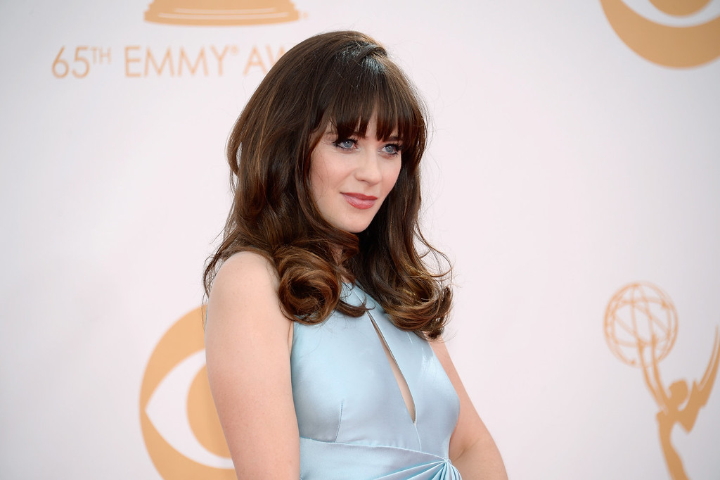 Description of . Actress Zooey Deschanel arrives at the 65th Annual Primetime Emmy Awards held at Nokia Theatre L.A. Live on September 22, 2013 in Los Angeles, California.  (Photo by Kevork Djansezian/Getty Images)