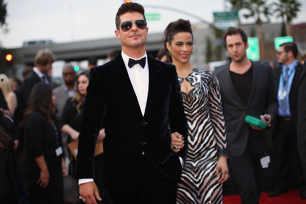 Description of . Recording artist Robin Thicke (L) and actress Paula Patton attend the 56th GRAMMY Awards at Staples Center on January 26, 2014 in Los Angeles, California.  (Photo by Christopher Polk/Getty Images for NARAS)