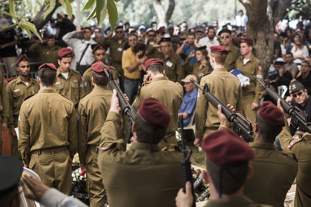 Description of . An honor guard participates in the funeral of Staff Sgt. Guy Algranati on July 31, 2014 in Tel Aviv, Israel. Since the beginning of Operation Protective Edge in Gaza, more than 50 Israeli soldiers have been killed along with over 1000 Palestinians. (Photo by Ilia Yefimovich/Getty Images)