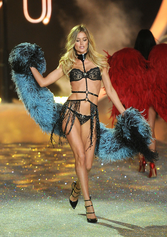 Description of . Model Doutzen Kroes walks the runway at the 2013 Victoria's Secret Fashion Show at Lexington Avenue Armory on November 13, 2013 in New York City.  (Photo by Jamie McCarthy/Getty Images)