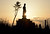 A Buddhist statue recently built in honor of tsunami victims is silhouetted at sunset on the seashore in Arahama district in Sendai, Miyagi Prefecture on March 11, 2013 on the second anniversary of the March 11, 2011 earthquake and tsunami disaster. Japan on March 11 marked the second anniversary of a ferocious tsunami that claimed nearly 19,000 lives and sparked the worst nuclear accident in a generation.  AFP PHOTO/Toru YAMANAKA/AFP/Getty Images