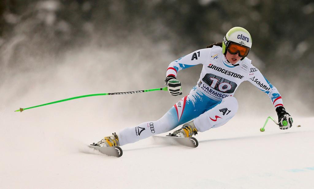 Description of . Anna Fenninger of Austria speeds down during the women's Alpine Skiing World Cup Downhill race in Garmisch-Partenkirchen March 2, 2013.  REUTERS/Wolfgang Rattay