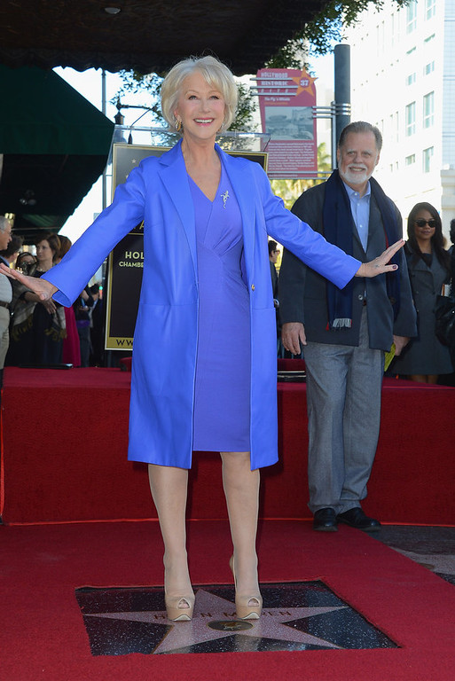 Description of . Actress   Helen Mirren, watched on by husband director Taylor Hackford, was Honored On The Hollywood Walk Of Fame with her own star on January 3, 2013 in Hollywood, California.  (Photo by Frazer Harrison/Getty Images)