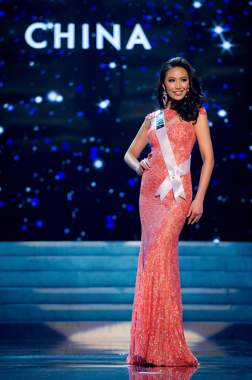 Description of . Miss China 2012 Ji Dan Xu competes in an evening gown of her choice during the Evening Gown Competition of the 2012 Miss Universe Presentation Show in Las Vegas, Nevada, December 13, 2012. The Miss Universe 2012 pageant will be held on December 19 at the Planet Hollywood Resort and Casino in Las Vegas. REUTERS/Darren Decker/Miss Universe Organization L.P/Handout