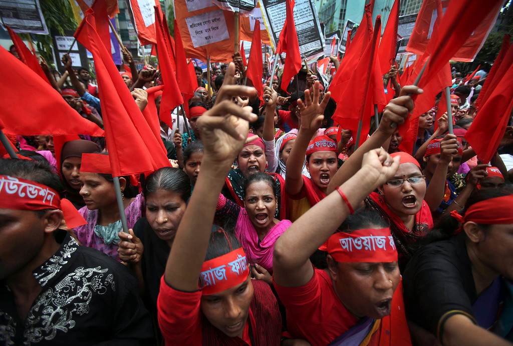 Description of . Women protesters shout slogans calling for better working conditions for garment workers during a May Day rally on Wednesday May 1, 2013 in Dhaka, Bangladesh.  (AP Photo/Wong Maye-E)