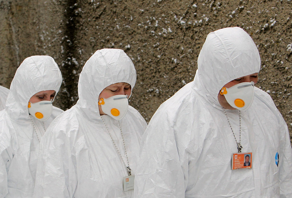 Description of . Workers wearing protective suits and masks exit a fallout shelter during a nuclear accident simulation as part of a safety regulations exercise at Nuclear Power Plant Dukovany in Dukovany March 26, 2013.     REUTERS/David W Cerny