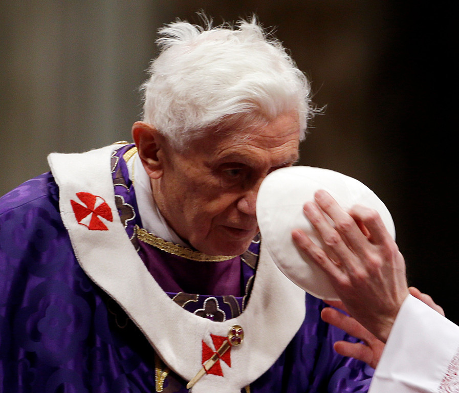 . Bishop Guido Marini holds Pope Benedict XVI\'s skull cap during the Ash Wednesday mass in St. Peter\'s Basilica at the Vatican, Wednesday, Feb. 13, 2013.  Ash Wednesday marks the beginning of Lent, a solemn period of 40 days of prayer and self-denial leading up to Easter. (AP Photo/Gregorio Borgia)