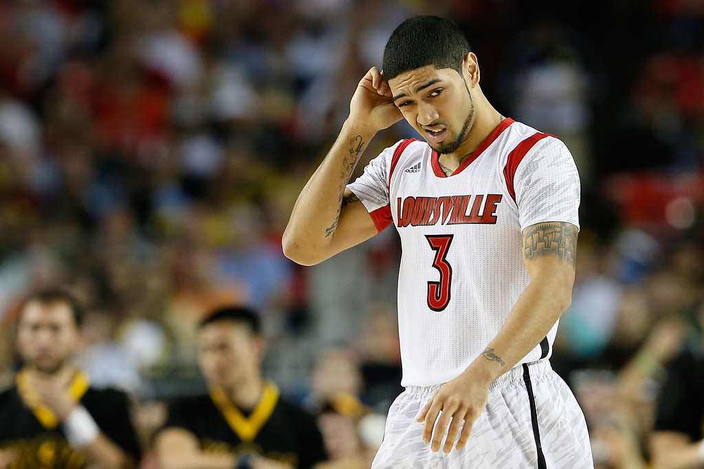 Description of . ATLANTA, GA - APRIL 06:  Peyton Siva #3 of the Louisville Cardinals reacts in the secon dhalf against the Wichita State Shockers during the 2013 NCAA Men's Final Four Semifinal at the Georgia Dome on April 6, 2013 in Atlanta, Georgia.  (Photo by Kevin C. Cox/Getty Images)