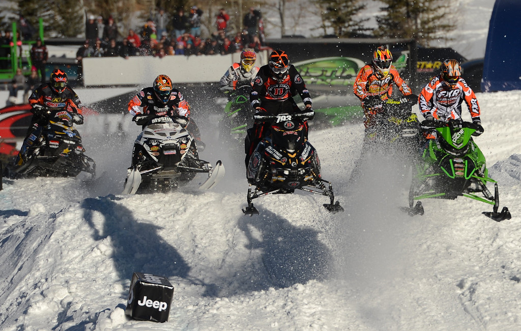 Description of . ASPEN, CO. - JANUARY 27:  Riders speed around snowmobile SnoCross course , January 27, 2013. The 2013 Winter X Games at Buttermilk Mountain in Aspen. (Photo By RJ Sangosti / The Denver Post)