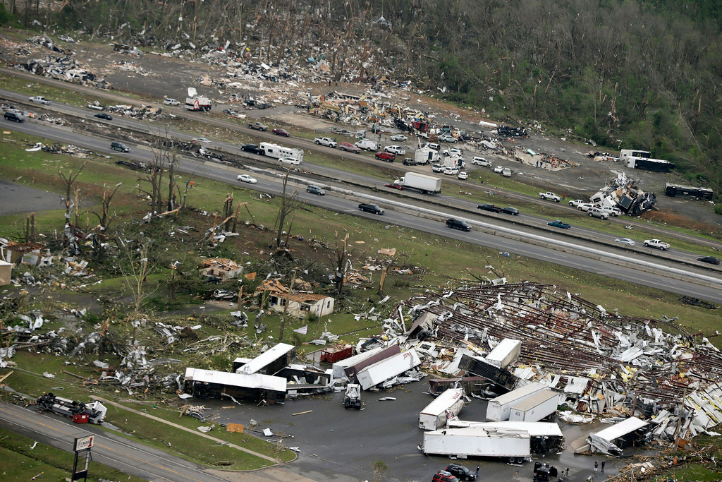 Description of . Traffic passes on Interstate 40 between destroyed businesses in Mayflower, Ark., Monday, April 28, 2014, after a tornado struck the town late Sunday. (AP Photo/Danny Johnston)