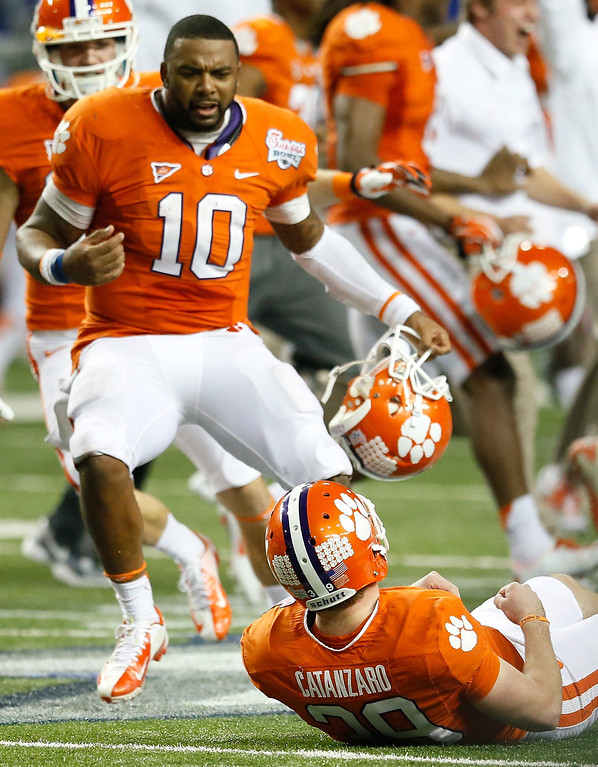 Description of . ATLANTA, GA - JANUARY 01:  Chandler Catanzaro #39 of the Clemson Tigers reacts after kicking the game-winning field goal against the LSU Tigers during the 2012 Chick-fil-A Bowl at Georgia Dome on December 31, 2012 in Atlanta, Georgia.  (Photo by Kevin C. Cox/Getty Images)