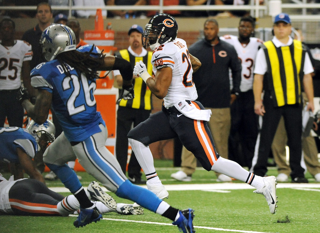 Description of . Chicago Bears running back Matt Forte (22) breaks for a 53-yard touchdown during the second quarter of an NFL football game against the Detroit Lions at Ford Field in Detroit, Sunday, Sept. 29, 2013. (AP Photo/Jose Juarez)