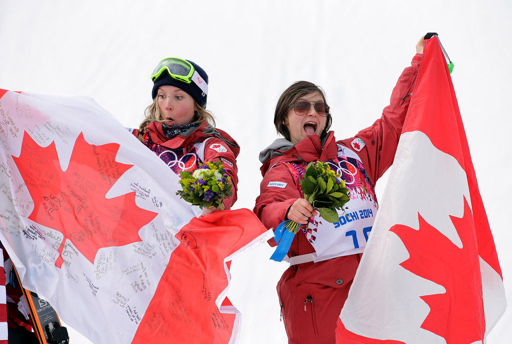 Description of . Canada\'s Dara Howell, left, celebrates with compatriot  Kim Lamarre after Howell took  the gold medal in the women\'s freestyle skiing slopestyle final at the Rosa Khutor Extreme Park at the 2014 Winter Olympics, Tuesday, Feb. 11, 2014, in Krasnaya Polyana, Russia.  Lamarre took the bronze medal. (AP Photo/Andy Wong)