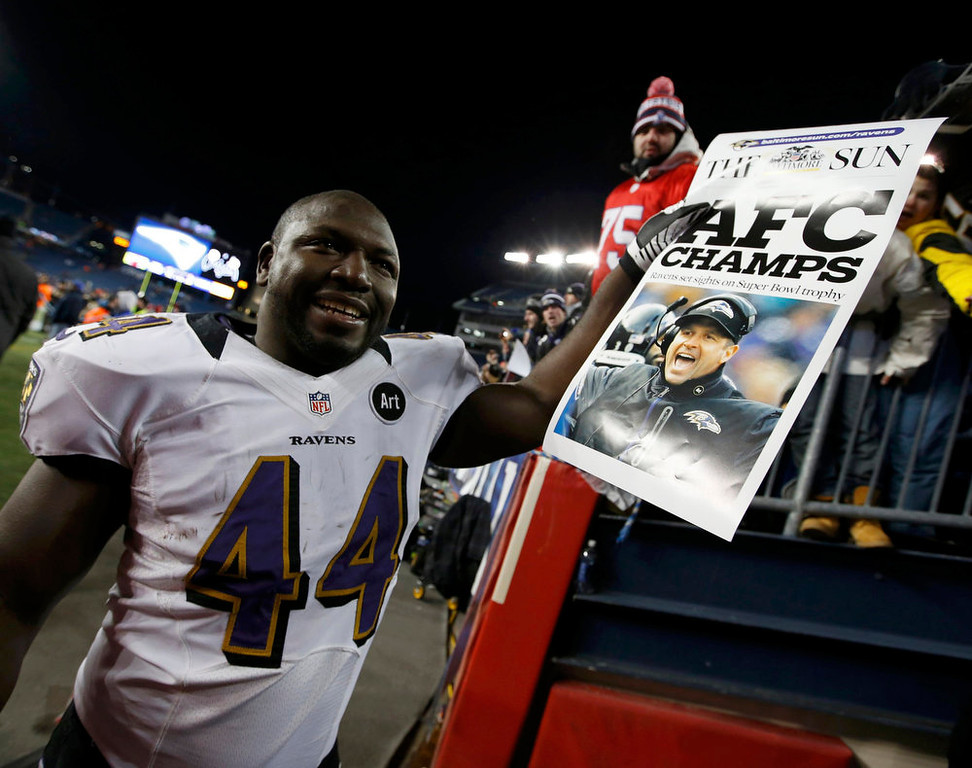 Description of . Baltimore Ravens' Vonta Leach celebrates with a newspaper headline after his team defeated the New England Patriots in the NFL AFC Championship football game in Foxborough, Massachusetts, January 20, 2013. REUTERS/Mike Segar