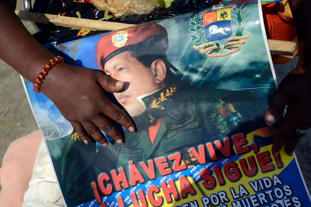 Description of . Supporters of late Venezuela's President Hugo Chavez await their turn to pay their last homage to their leader, in Caracas, on March 7, 2013.   AFP PHOTO/LEO RAMIREZ/AFP/Getty Images