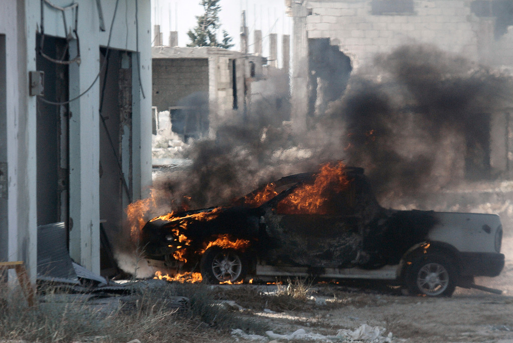 Description of . A vehicle is seen burning in the village of Buweida, north of Qusayr, in Syria's central Homs province on June 7, 2013 as regime forces sought to mop up the final pockets of rebel resistance north of Qusayr, after retaking the key town that was an insurgent bastion for a year, a watchdog said. Qusayr's capture gives President Bashar al-Assad the upper hand if a US-Russian plan for the first direct peace talks with his opponents materialises, analysts say. STR/AFP/Getty Images
