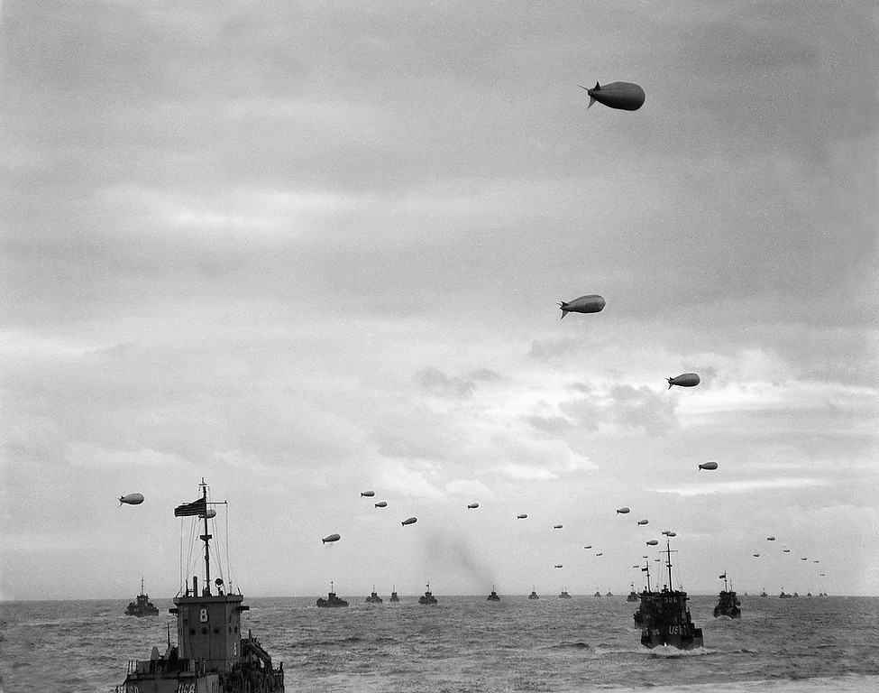 Description of . Barrage balloons are used for aerial protection as part of the invasion fleet, carrying men and supplies move across the channel  towards the French invasion coast. .(AP Photo /Peter Carroll )