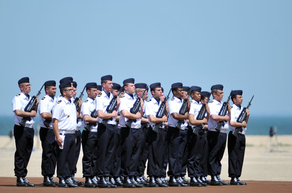 Description of . Members of the French Gendarmerie stand at attention to an international D-Day commemoration ceremony on the beach of Ouistreham, Normandy, on June 6, 2014, marking the 70th anniversary of the World War II Allied landings in Normandy. AFP PHOTO / GUILLAUME  SOUVANT/AFP/Getty Images