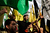 Palestinians celebrate waving Fatah and Hamas flags at the square of the Unknown Soldier in central Gaza City on November 22, 2012. Israeli politicians returned to the campaign trail as the streets of Gaza came back to life after a truce ended eight days of bloodshed, with both sides claiming victory while remaining wary. AFP PHOTO/MARCO LONGARI         (Photo credit should read MARCO LONGARI/AFP/Getty Images)