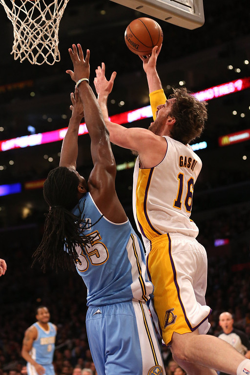 Description of . Pau Gasol #16 of the Los Angeles Lakers shoots over Kenneth Faried #35 of the Denver Nuggets at Staples Center on January 6, 2013 in Los Angeles, California.   (Photo by Stephen Dunn/Getty Images)