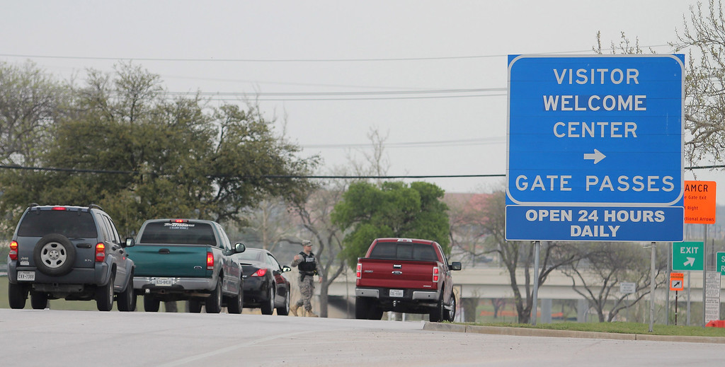 Description of . Motorists stop at the entrance to the Bernie Main Gate of Fort Hood, Texas, Wednesday, April 2, 2014, after a shooting occurred on the military base. (AP Photo/The Killeen Daily Herald, Catrina Rawson)
