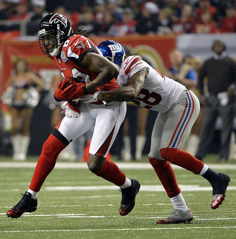 Description of . Atlanta Falcons wide receiver Roddy White (84) runs against New York Giants cornerback Jayron Hosley (28) during the second half of an NFL football game on Sunday, Dec. 16, 2012, in Atlanta. (AP Photo/Rich Addicks)