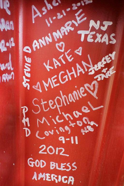 Description of . This Jan. 15, 2013 photo shows graffiti left by visitors to the World Trade Center on a steel column on the 104th floor of One World Trade Center in New York. Construction workers finishing New York's tallest building at the World Trade Center are leaving their personal marks on the concrete and steel in the form of graffiti. (AP Photo/Mark Lennihan)