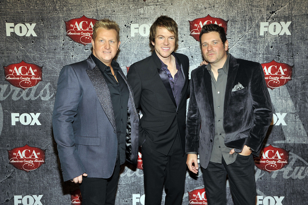 Description of . From left, musicians Gary LeVox, Joe Don Rooney and Jay DeMarcus of Rascal Flatts arrive at the American Country Awards on Monday, Dec. 10, 2012, in Las Vegas. (Photo by Jeff Bottari/Invision/AP)